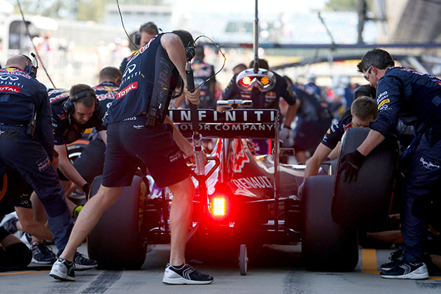 Daniil Kvyat of Infiniti Red Bull Racing returns to the garage(Photo by Charles Coates/Getty Images)