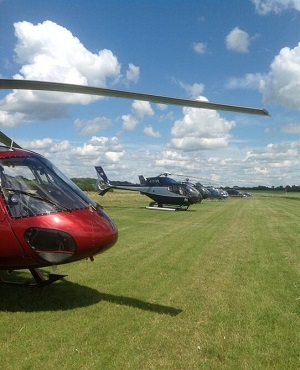 Our fleet of helicopters parked at Turweston Airfield