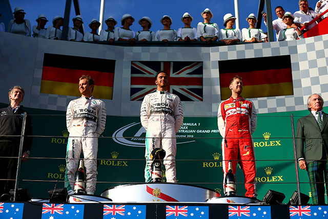 Lewis Hamilton of Great Britain and Mercedes GP stands on the podium with Nico Rosberg of Germany and Mercedes GP and Sebastian Vettel of Germany and Ferrari after winning the Australian Formula One Grand Prix at Albert Park © Red Bull Media House