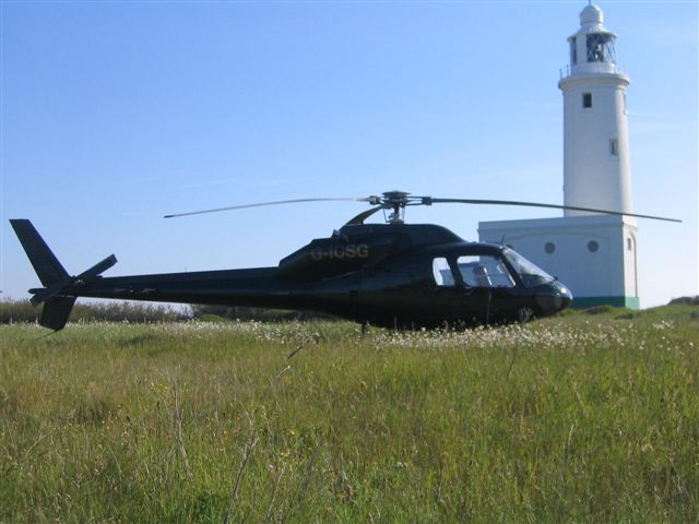 Helicopter next to lighthouse