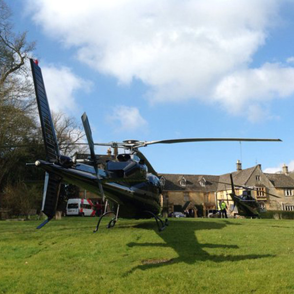 Helicopter on the lawn at Lords of the Manor