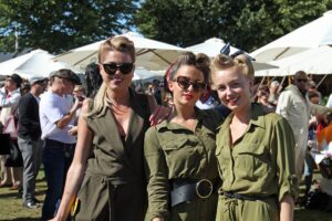 3 women dressed in 1940's atire at Goodwood Revival